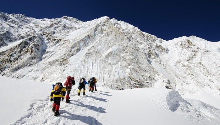 Asia, Nepal, Himalayas, Sagarmatha National Park, Solu Khumbu Everest Region, climbers walking below Nuptse making their way to camp 2 on Mt Everest
