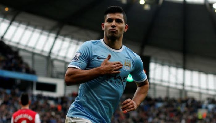 """Manchester City's Sergio Aguero celebrates his goal during their English Premier League soccer match against Arsenal at the Etihad stadium in Manchester, northern England December 14, 2013. REUTERS/Phil Noble (BRITAIN - Tags: SPORT SOCCER) NO USE WITH UNAUTHORIZED AUDIO, VIDEO, DATA, FIXTURE LISTS, CLUB/LEAGUE LOGOS OR """"LIVE"""" SERVICES. ONLINE IN-MATCH USE LIMITED TO 45 IMAGES, NO VIDEO EMULATION. NO USE IN BETTING, GAMES OR SINGLE CLUB/LEAGUE/PLAYER PUBLICATIONS. FOR EDITORIAL USE ONLY. NOT FOR SALE FOR MARKETING OR ADVERTISING CAMPAIGNS"""