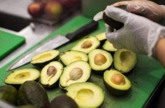 A worker prepares avocados inside a restaurant in Massachusetts, U.S. Photographer: Adam Glanzman/Bloomberg